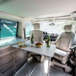 vw campervan rental Switzerland, comfortable living cabin with 4 seats