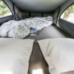 Campervan rental Switzerland, sleeping comfort for two persons in upper bunk