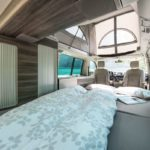 Premium campervan rental company Switzerland, sleeping comfort on main deck for two adults